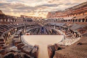 Scenic view of Roman Colosseum interior at sunset, Rome, Italy