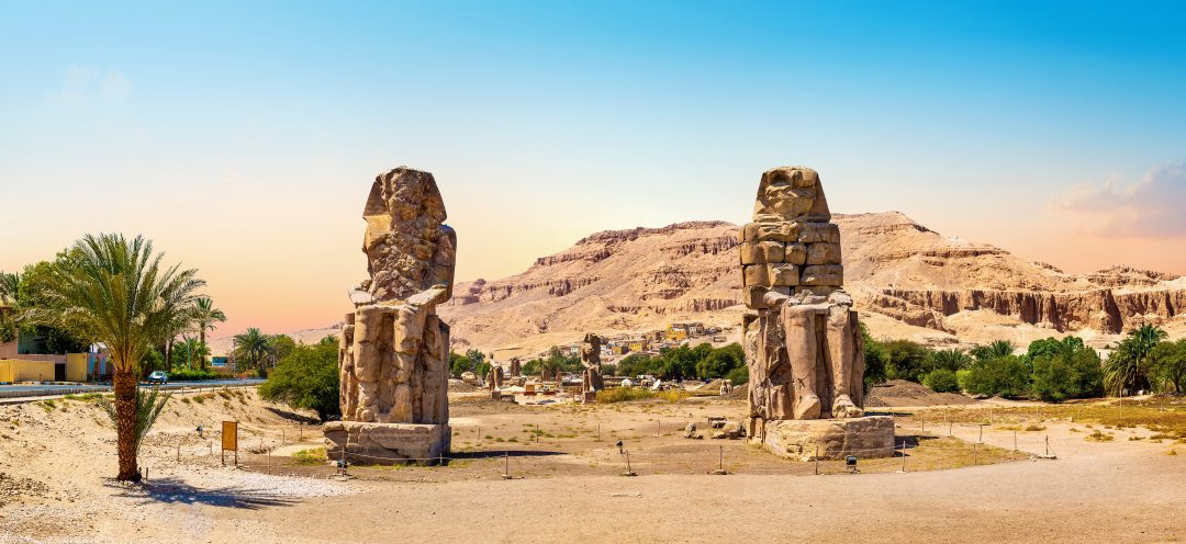 Egypt. Luxor. The Colossi of Memnon - two massive stone statues of Pharaoh Amenhotep